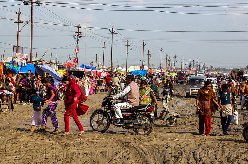 muddy market street (india), botorcycle, cars, hindu pilgrimage, hinduism, india, maha kumbh mela, mud ruts, muddy road, muddy street, traffic, underbone motorcycle, walking