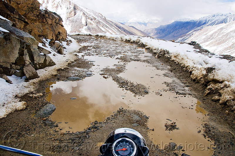 muddy road - khardungla pass - ladakh (india), khardung la pass, ladakh, motorbike touring, motorcycle touring, mountain pass, mountains, mud, road, royal enfield bullet, snow