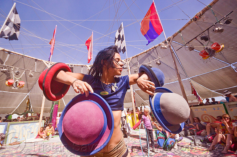 mumu juggling with hats - burning man 2012, bowler hats, burning man, center camp, circus performance, hat juggling, mumu