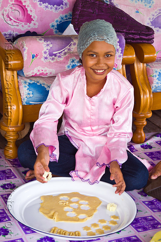 muslim girl making ramadan cookies - maizatul masleeza, borneo, cookie cutter, cookie dough, cooking, maizatul masleeza, malaysia, muslim, pink, ramadan cookies, sitting, woman