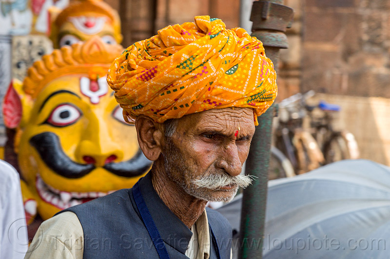 mustachioed hindu pilgrim at the lingaraja temple - bhubaneswar (india), headdress, headwear, hindu temple, hinduism, lingaraj, lingaraj temple, man, moustaches, mustache, painted, people, sculpture, stone, stone tiger, tilak, tilaka, turban, yellow