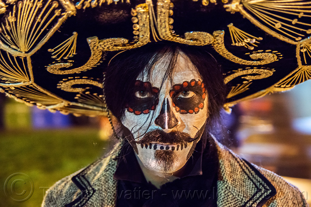 mustachioed man with dramatic sugar skull makeup - mexican sombrero - dia de los muertos, day of the dead, dia de los muertos, face painting, facepaint, goatee, halloween, hat, man, mustache, night, skull makeup, sombrero
