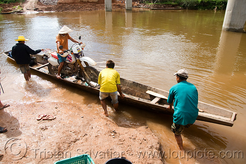 my motorcycle on a very small river-crossing boat (laos), 250cc, dual-sport, ferry boat, honda motorcycle, honda xr 250, kong lor, laos, motorcycle touring, river boats, river crossing, river ferry, road, rowing boat, small boat