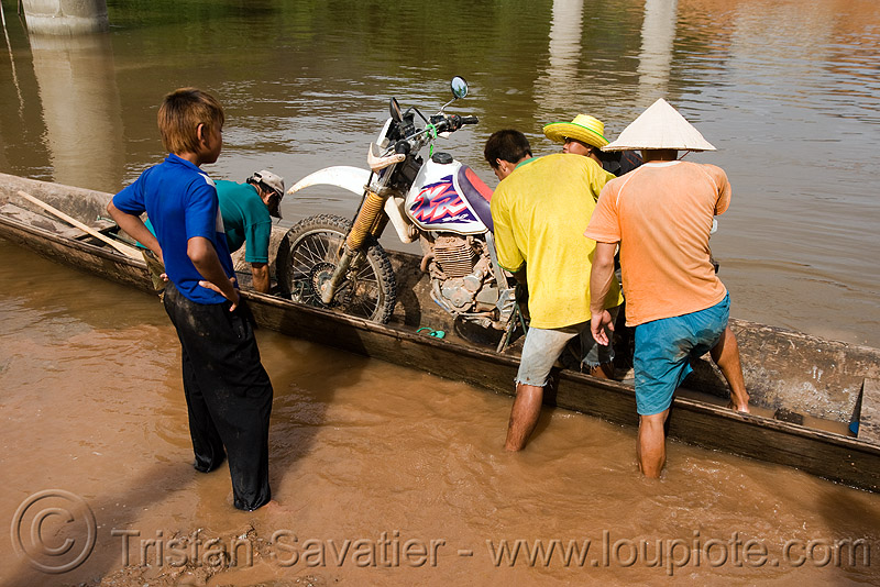 my motorcycle on a very small river-crossing boat (laos), 250cc, dual-sport, ferry boat, honda motorcycle, honda xr 250, kong lor, laos, motorcycle touring, river boats, river crossing, river ferry, road, rowing boat, small boat, wading