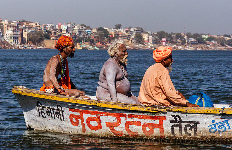 naga sadhu on small boat on the ganges river - varanasi (india), ganga, ganges river, hindu, hinduism, holy ash, men, naga babas, naga sadhus, pilgrims, river boat, sacred ash, varanasi, vibhuti