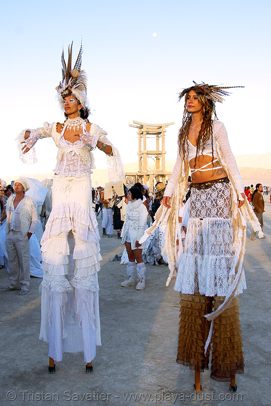 natalia and  pema at the silent white procession - burning man 2007, burning man, dawn, feathers, natalia, pema, stilt walkers, stilts, stiltwalker, stiltwalking, white morning, women