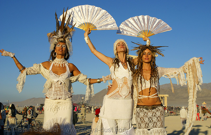 natalia, audette sophia, and  pema at the silent white procession - burning man 2007, audette sophia, burning man, dawn, fans, feathers, natalia, pema, silent white procession, stilts, stiltwalkers, stiltwalking, sun rise, white morning, women