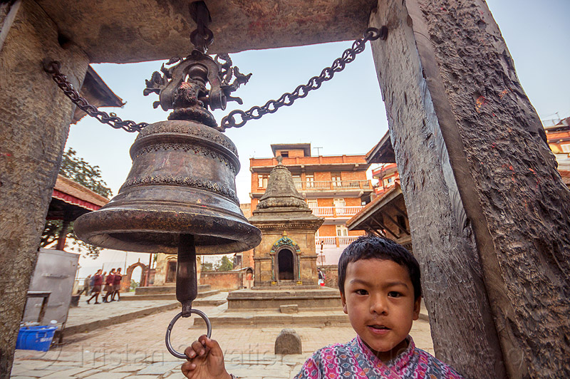 nepali boy ringing temple bell (nepal), bagh bhairav, bagh bhairav temple, child, hindu temple, hinduism, kid, kirtipur, people