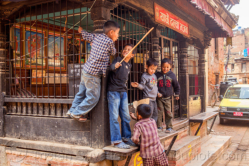 nepali boys playing around a pati (nepal), bhaktapur, boys, children, grid, kids, pati, playing, street