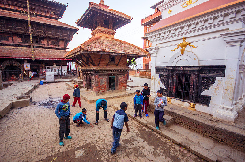 nepali boys playing on square near bagh bhairav temple (nepal), bagh bhairav temple, boys, children, hindu temple, hinduism, kids, kirtipur, playing