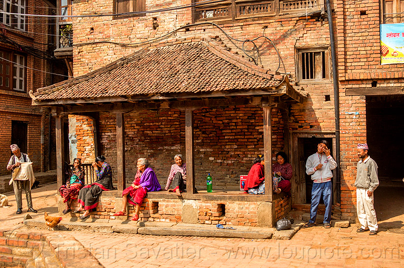 nepali people sitting in a pati (nepal), bhaktapur, pati, women