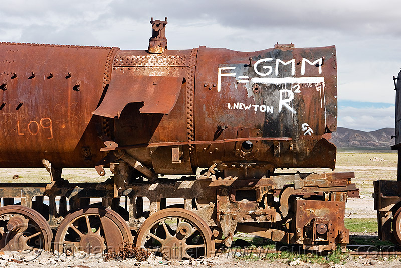 newton's universal law of gravitation equation - graffiti on steam locomotive, abandoned, enfe, equation, fca, graffiti, gravitation, newton, physics, railroad, railway, rusted, rusty, science, scrapyard, steam engine, steam locomotive, steam train engine, train cemetery, train graveyard, train junkyard, uyuni