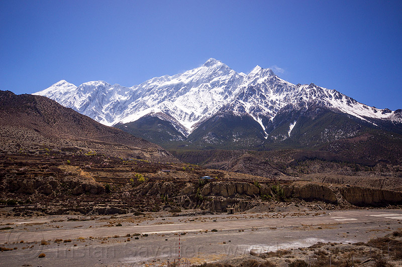 nilgiri summit behind the runway of jomsom airport - annapurnas (nepal), airport, jomsom, mountains, nilgiri, runway