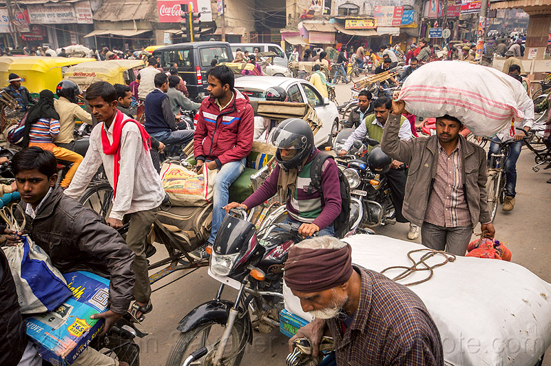 normal traffic jam in busy street (india), bicycles, bikes, carrying, cars, crowd, cycle rickshaws, gridlock, motorbikes, motorcycles, people, sacks, varanasi