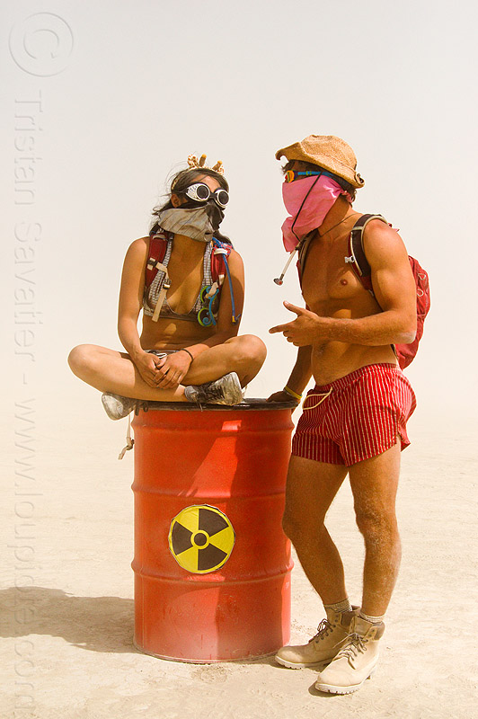 nuclear waste drum - burning man 2013, barrel, burning man, couple, drum, dust storm, nuclear waste, radioactive waste, red, sitting, unidentified art, white out, woman