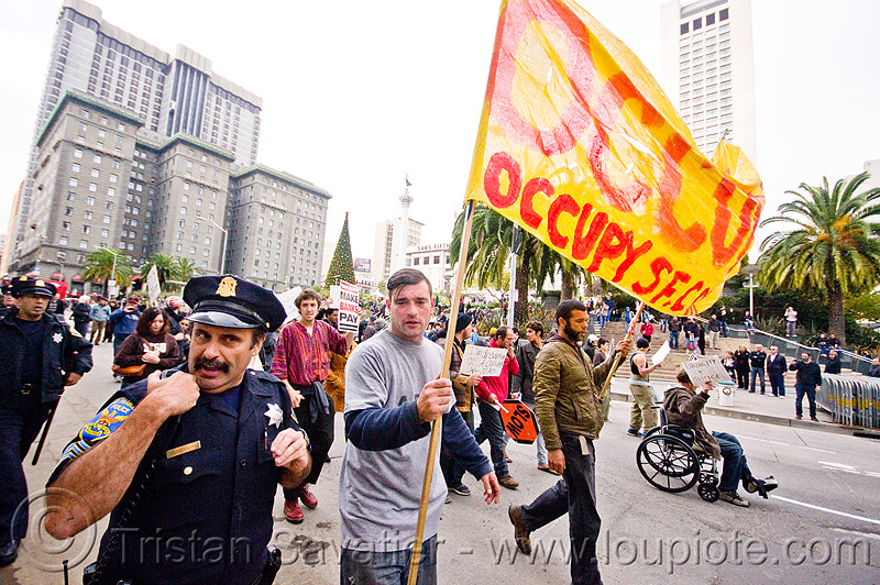 occupy black friday protest (san francisco), black friday, demonstration, demonstrators, law enforcement, occupy, ows, police, protest, protesters, sfpd, sign, street, union square, wheel chair