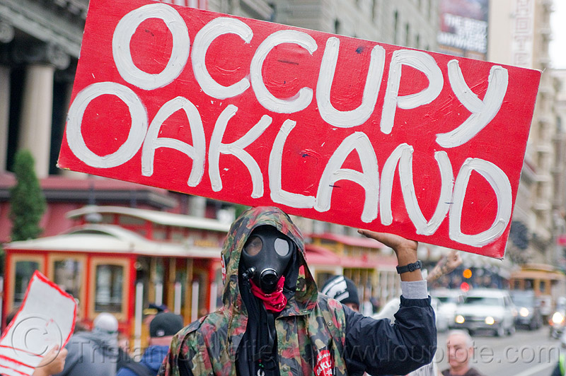 occupy oakland, black friday, cablecar, demonstration, demonstrators, gas mask, oakland, occupy, ows, protest, protesters, sign, street, union square