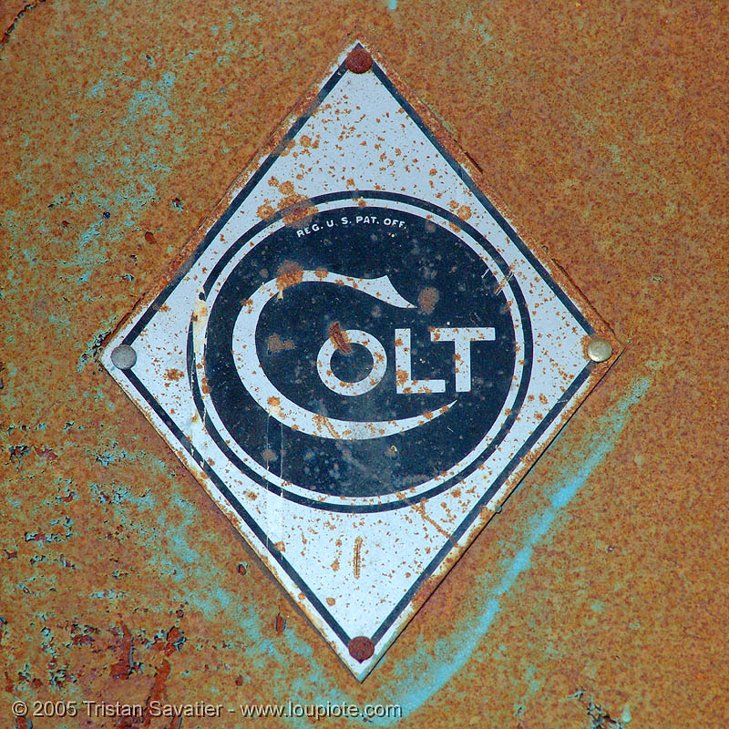 colt, abandoned, circle, colt defense, decay, diamond, hunter's point, industrial, lozenge, metal, plate, rhombus, rust, rusted, rusty