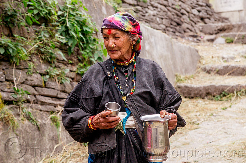 old indian woman with jar of chai (india), chai, dhauliganga valley, ear piercing, earring, jar, jewelry, metal, mountains, necklaces, nose piercing, nostril piercing, old woman, raini chak lata, spice tea, stair, steps, village