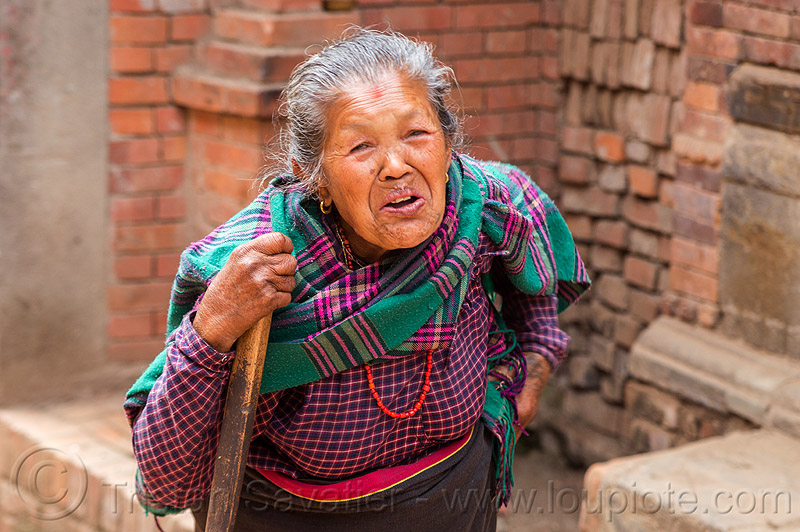 old nepali woman (nepal), bhaktapur, standing, walking stick, woman