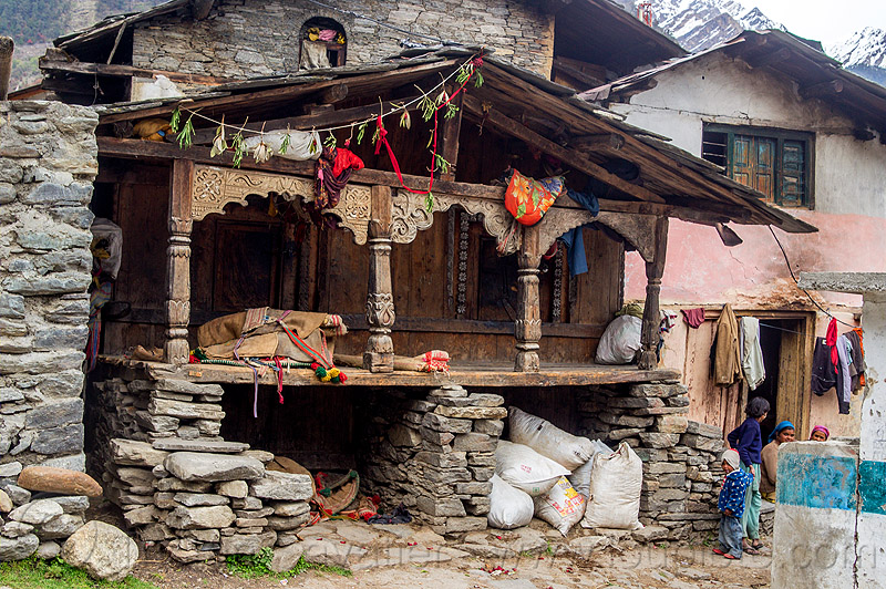 old traditional house with wood carvings in himalayan village (india), carved, child, columns, house, india, intricate, janki chatti, kid, village, wood carving