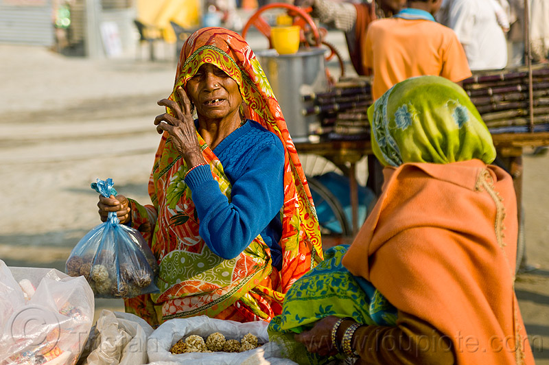 old woman selling puffed rice balls (india), kumbha mela, maha kumbh mela, offerings, old woman, plastic bags, street food, street vendor, women