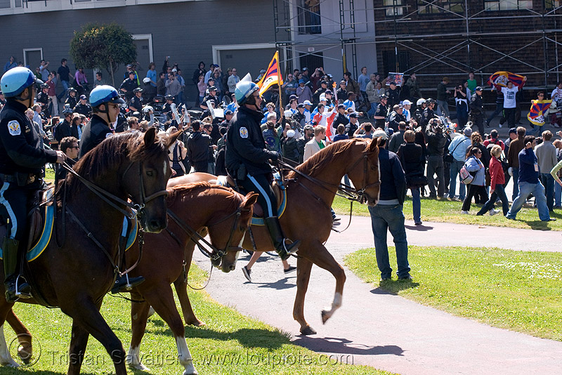olympic torch relay / run (san francisco), flames, horseback riding, horses, law enforcement, olympics, park police, people, sf park police, us park police