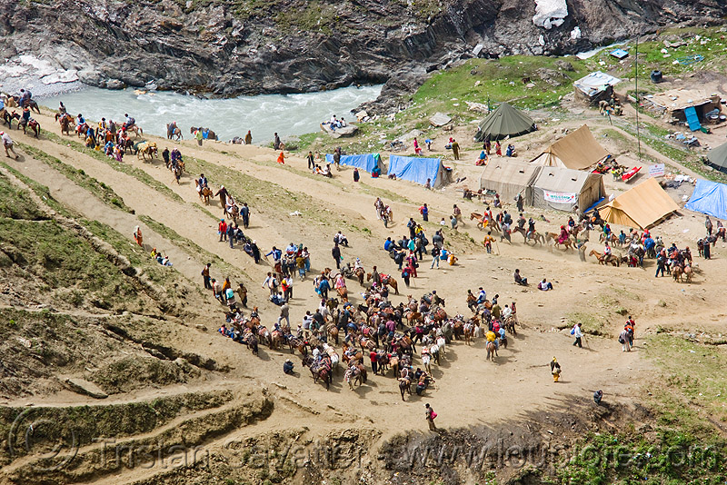 one of the camps on the trail - amarnath yatra (pilgrimage) - kashmir, amarnath yatra, camp, crowd, encampment, kashmir, mountain trail, mountains, pilgrimage, pilgrims, river bed, tents, trekking, yatris, अमरनाथ गुफा