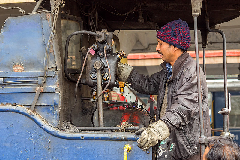 operator at the controls of a steam locomotive - darjeeling (india), 788 tusker, controls, darjeeling himalayan railway, darjeeling toy train, hydrostatic displacement lubricator, hydrostatic lubricator, india, man, mechanical lubricator, narrow gauge, operator, railroad, steam engine, steam locomotive, steam train engine