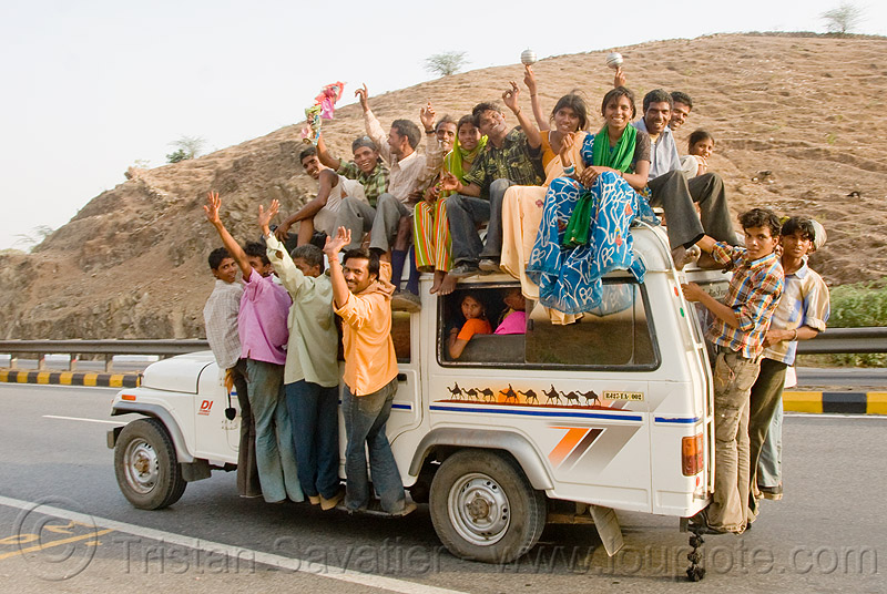overloaded car - wedding party on mahindra taxi jeep (india), 4x4, car, crowd, india, indian wedding, jeep, mahindra, men, overloaded, road, taxi, women