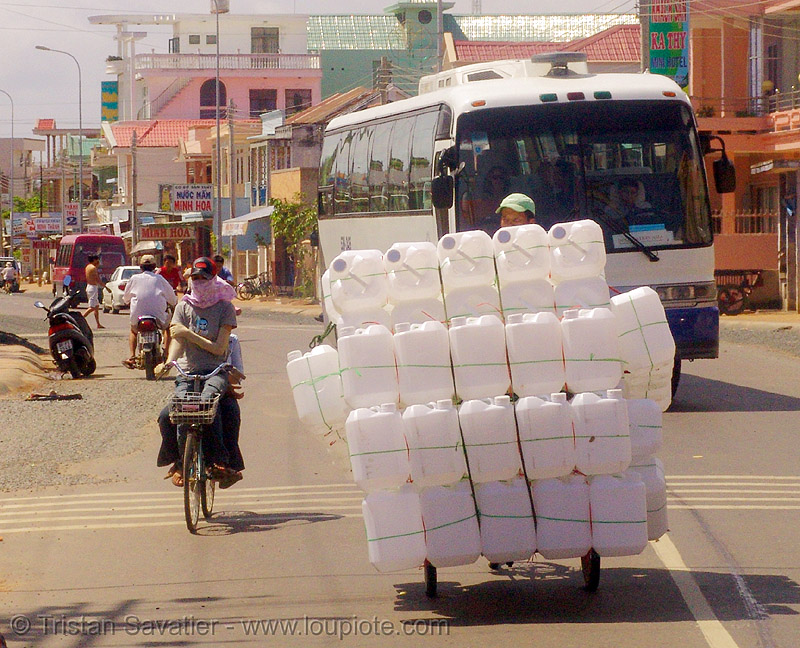 oversize load - plastic cans on tricycle - tricycle - vietnam, cargo tricycle, cargo trike, commerce, cycle rickshaw, freight tricycle, freight trike, jerrycans, oversize load, plastic cans, plastic containers, road, street, traffic