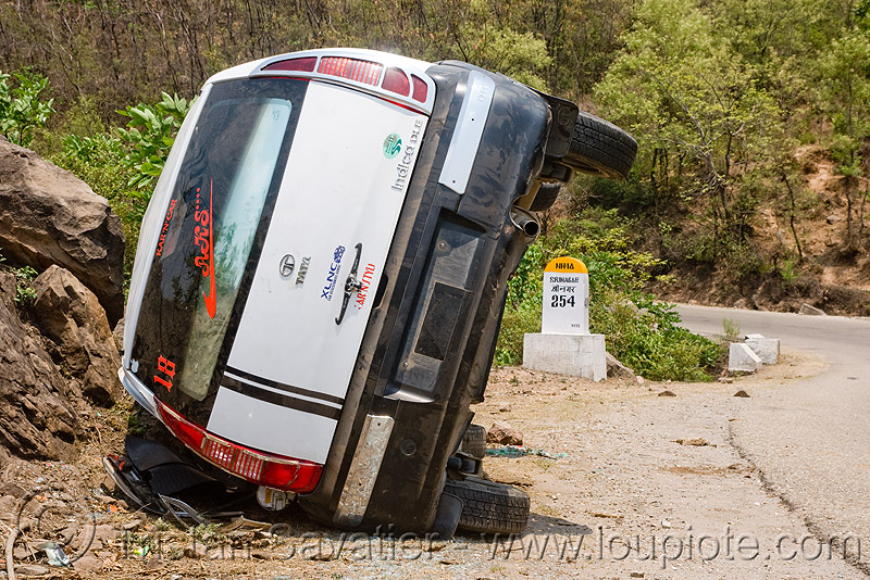 overturned car - TATA indica, car accident, car crash, india, kashmir, overturned car, rear, road, rollover, tata indica, tata motors, traffic accident, white, wreck