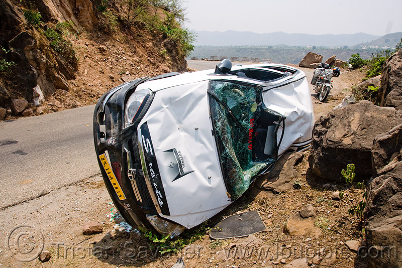 overturned car - traffic accident - indica DLE, car accident, car crash, india, kashmir, overturned car, road, rollover, tata indica, tata motors, traffic accident, white, wreck