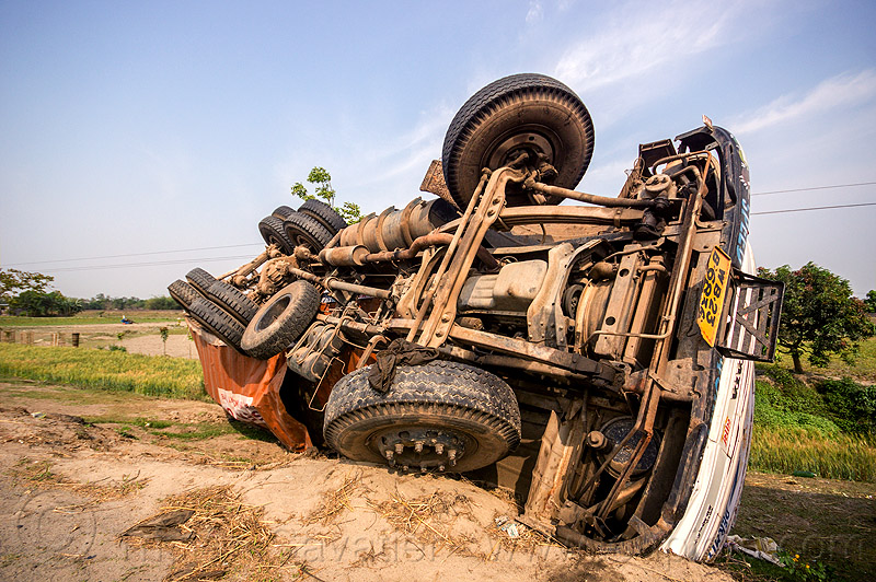overturned truck in ditch (india), crash, ditch, lorry, overturned, road, rollover, tata motors, traffic accident, truck accident, twisted, underbelly, up-side-down, west bengal, wreck