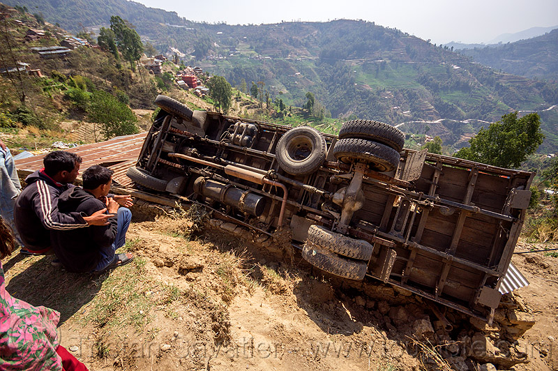overturned truck in ditch off mountain road (nepal), accident, crash, lorry, people, rollover, tata, tata motors, traffic accident, truck accident, underbelly, up-side-down, wreck