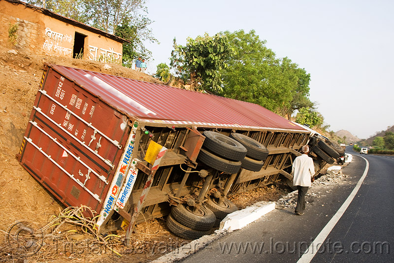 overturned truck (india), artic, articulated lorry, container, crash, ditch, india, man, overturned truck, road, rollover, semi truck, tata motors, traffic accident, truck accident, wreck