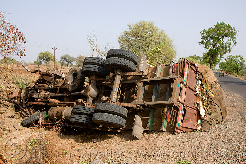 overturned truck (india), crash, ditch, india, lorry, overturned truck, road, rollover, tata motors, traffic accident, truck accident, underbelly, wreck
