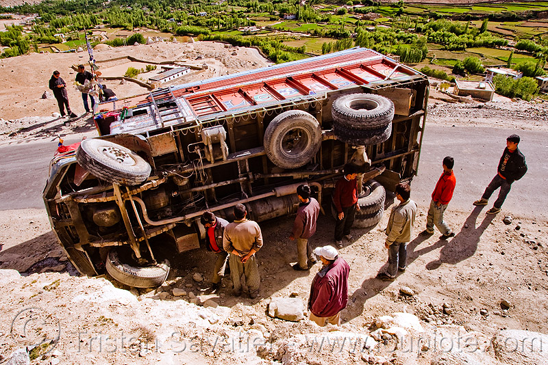 overturned truck - khardungla pass - ladakh (india), crash, india, khardung la pass, ladakh, lorry, men, mountain pass, overturned truck, road, rollover, tata motors, traffic accident, truck accident, wreck