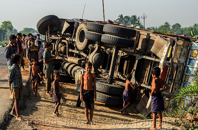 overturned truck on road side (india), boys, children, crash, crowd, lorry, men, overturned truck, road, rollover, tata motors, traffic accident, truck accident, underbelly, wreck