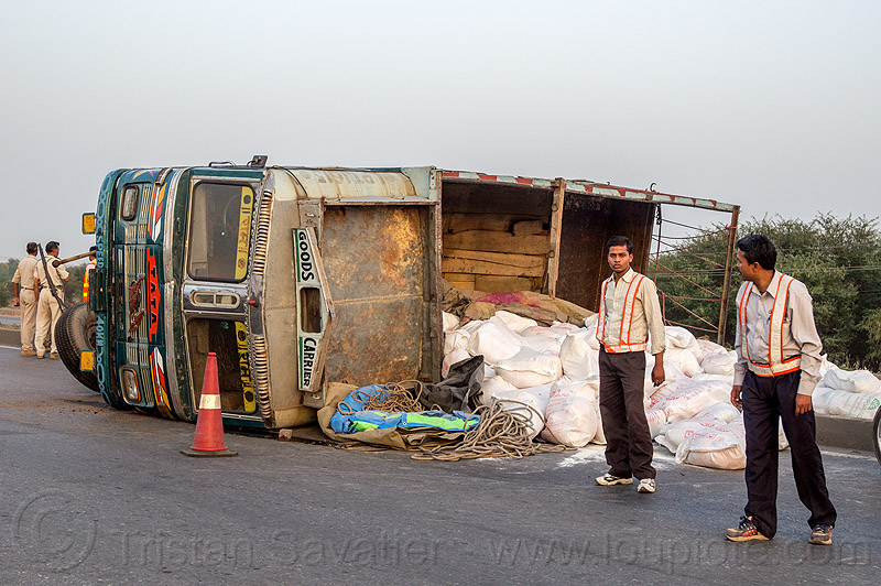 overturned truck - spilled load of rice bags (india), accident, cargo, crash, freight, lorry, men, people, road, rollover, sacks, tata, tata motors, traffic accident, truck accident, wreck