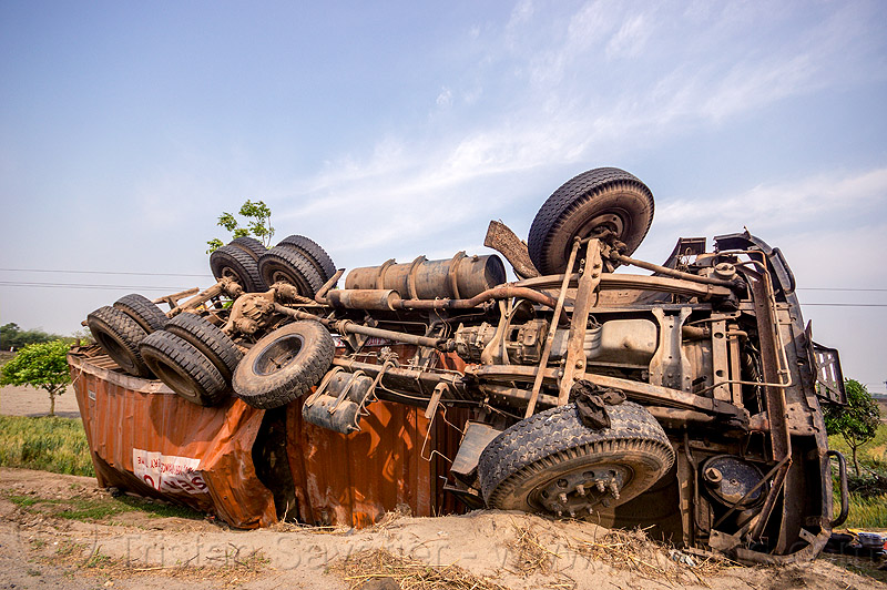 overturned truck - TATA - accident (india), crash, ditch, india, lorry, overturned, road, rollover, tata motors, traffic accident, truck accident, twisted, underbelly, up-side-down, west bengal, wreck