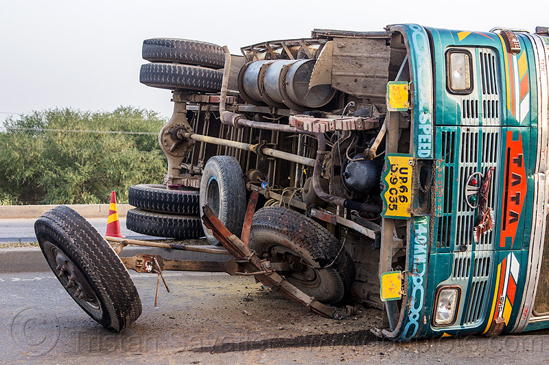 overturned truck underbelly (india), crash, lorry, median, overturned, road, rollover, tata motors, traffic accident, truck accident, underbelly, wheels, wreck