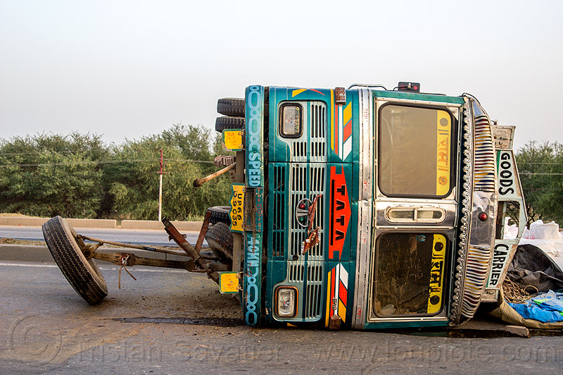 overturned truck with front wheels ripped off (india), crash, india, lorry, median, overturned, road, rollover, tata motors, traffic accident, truck accident, wreck