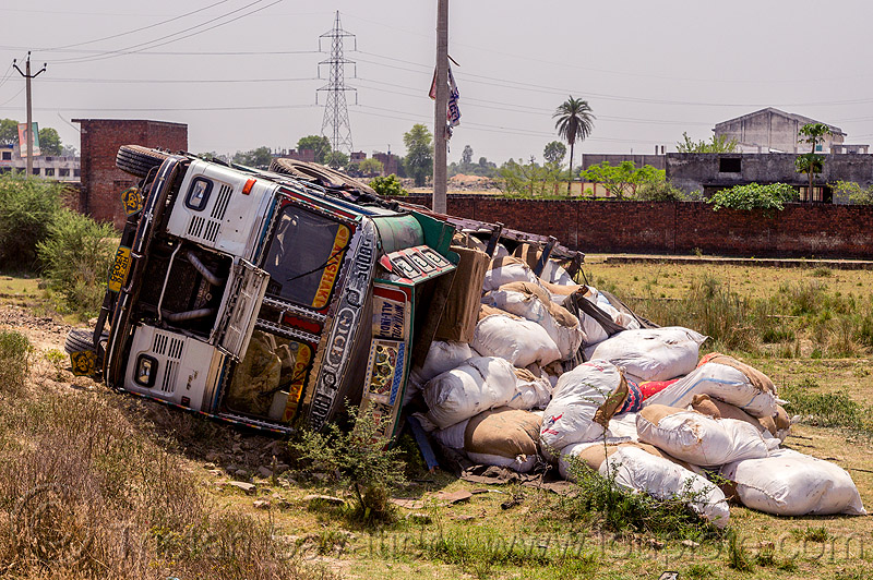 overturned truck with spilled cargo (india), 2515 cex, accident, crash, freight, load, lorry, road, rollover, sacks, tata, tata motors, traffic accident, truck accident, wreck