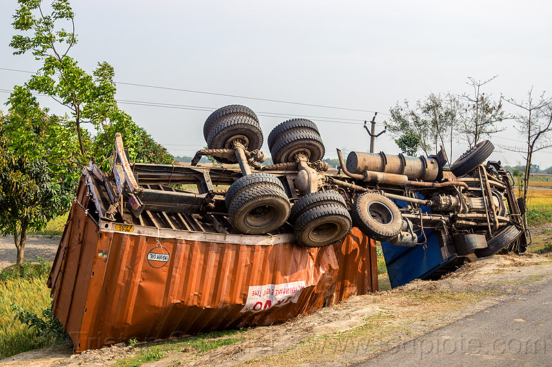 overturned truck with twisted frame (india), crash, ditch, lorry, overturned, road, rollover, tata motors, traffic accident, truck accident, twisted, underbelly, up-side-down, west bengal, wreck