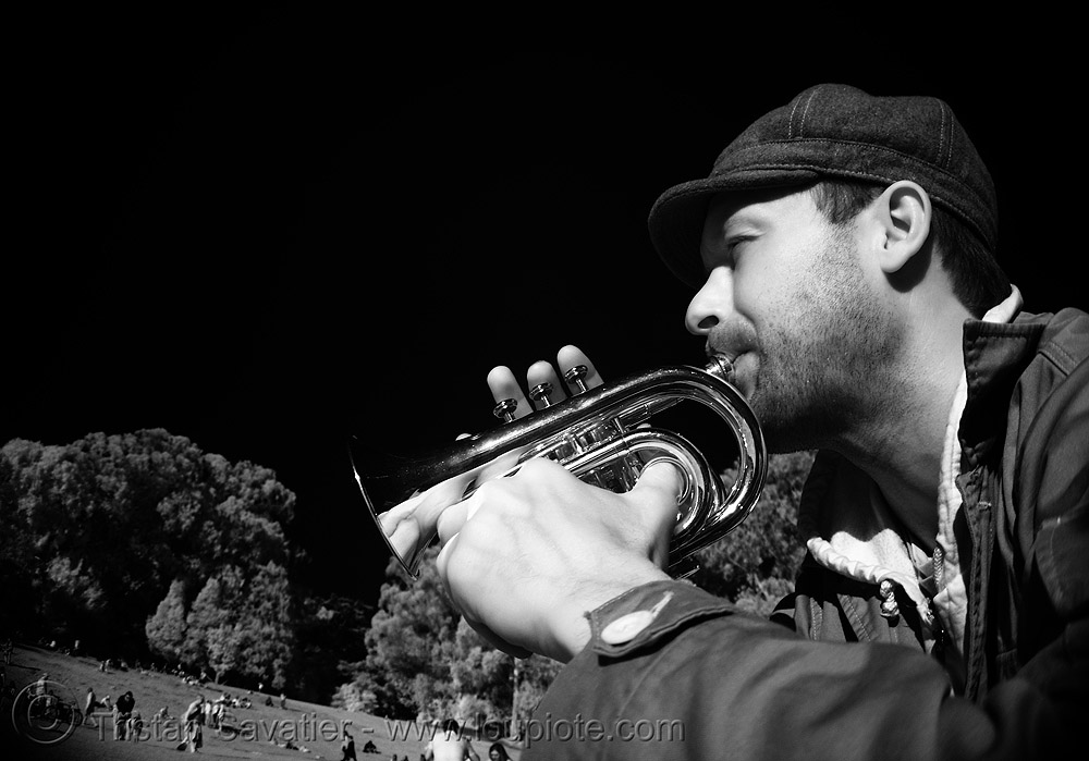 pan playing piccolo trumpet, brass, golden gate park, man, musician, near infrared, piccolo trumpet, small trumpet