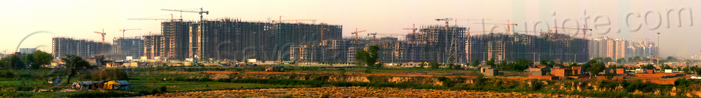 "panorama view of the construction of ""gaur city 1"" - planned urban development (india), building construction, buildings, construction cranes, gaur city, greater noida, india, panorama, planned city, urban development, urban planning"