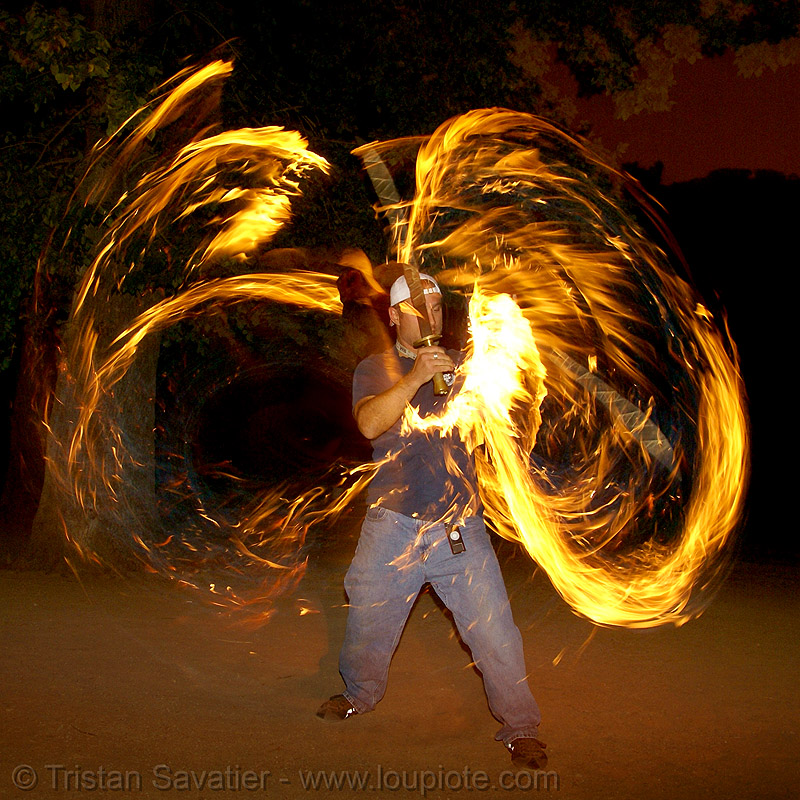paramedic spinning fire swords (san francisco), fire dancer, fire dancing, fire performer, fire spinning, fire swords, night, spinning fire