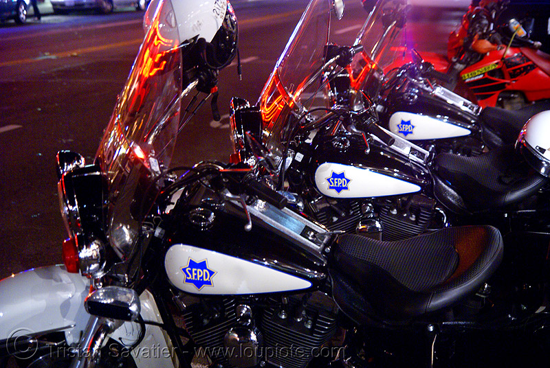 police motorcycles - SFPD  (san francisco), cops, davidson, harley, harley-davidson, law enforcement, motor cop, motor officer, motorbikes, motorcycle police, motorcycle unit, night, parked, san francisco police department, street