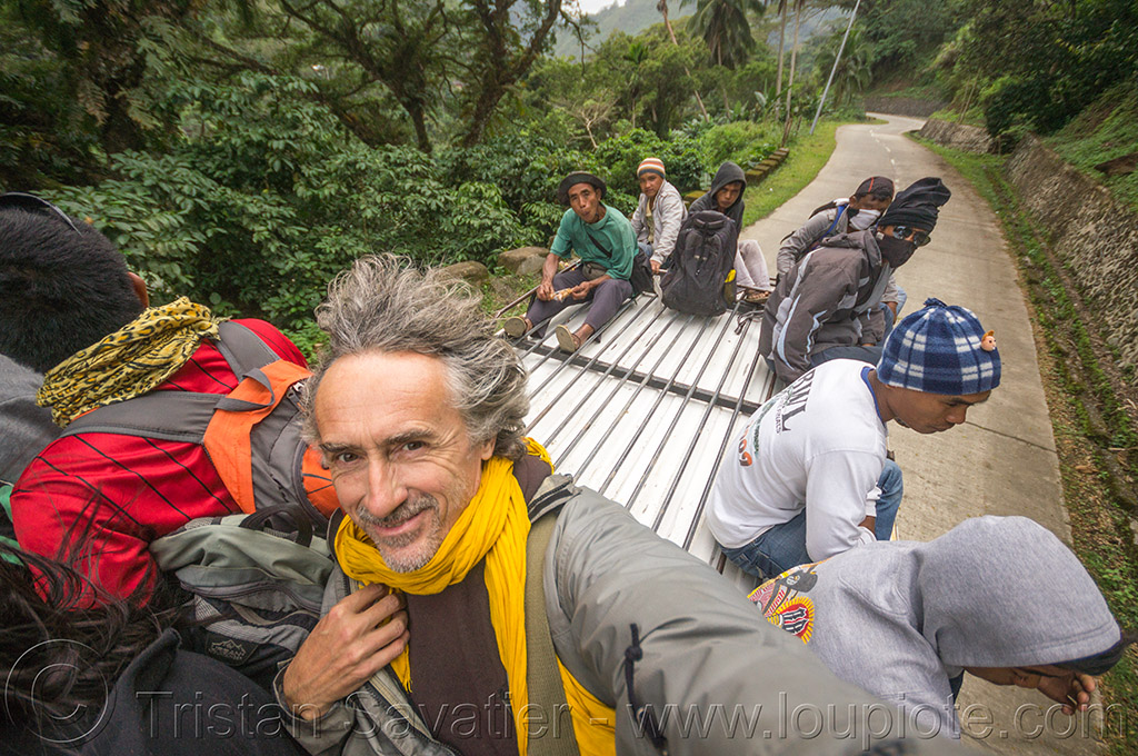 passengers riding on roof of jeepney (philippines), cordillera, jeepney, passengers, philippines, public transportation, road, roof, self portrait, selfie, sitting, tristan savatier